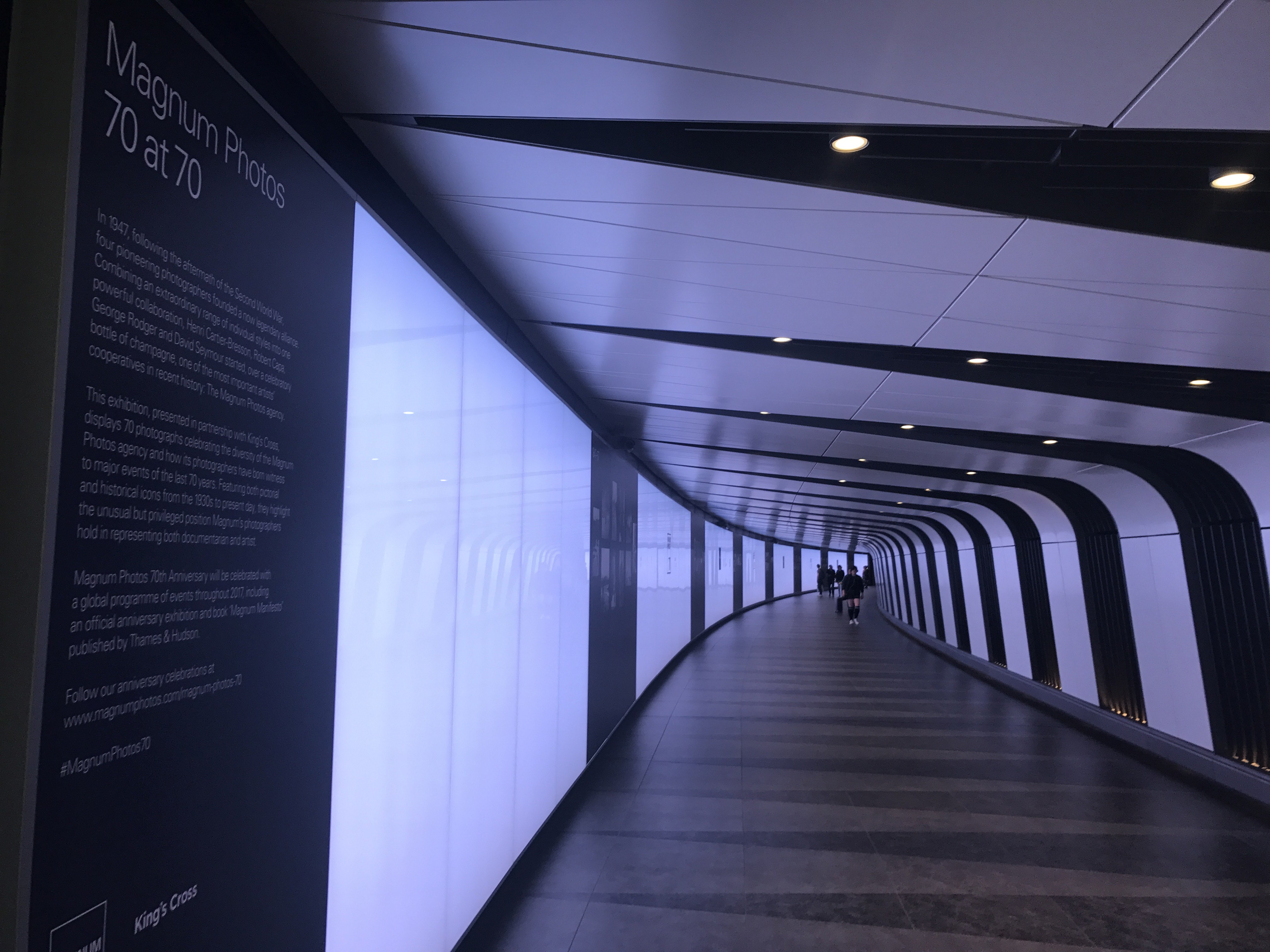 Image of a white and black tunnel with the Magnum photography exhibition text in the foreground.