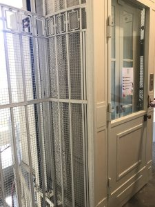 Image of an older style lift with gates
