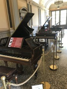Image of 3 older grand pianos