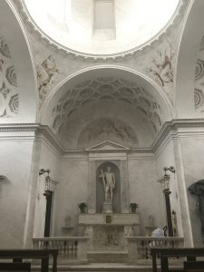 Best things to do in Bellagio, Italy - the chapel in the giardini di villa melzi. Image of interior of a chapel. Walls are white with lots of sculpture and decoration