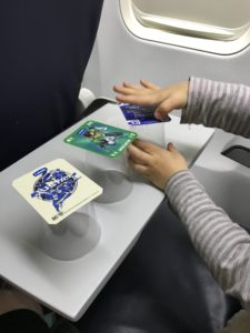 Travel with kids - entertaining a 2 year old on a flight with 3 cups and 3 cards