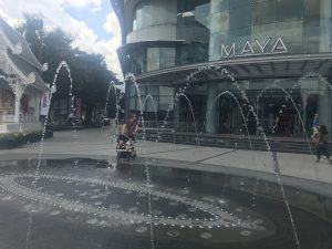 Image of fountain in front of a shopping centre. The word 'MAYA' is visible.