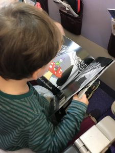 Flying with children successfully is all about entertaining them and helping them nap. Here's Jack reading 'In the Foggy Foggy Forest' (his favourite book) on the plane.
