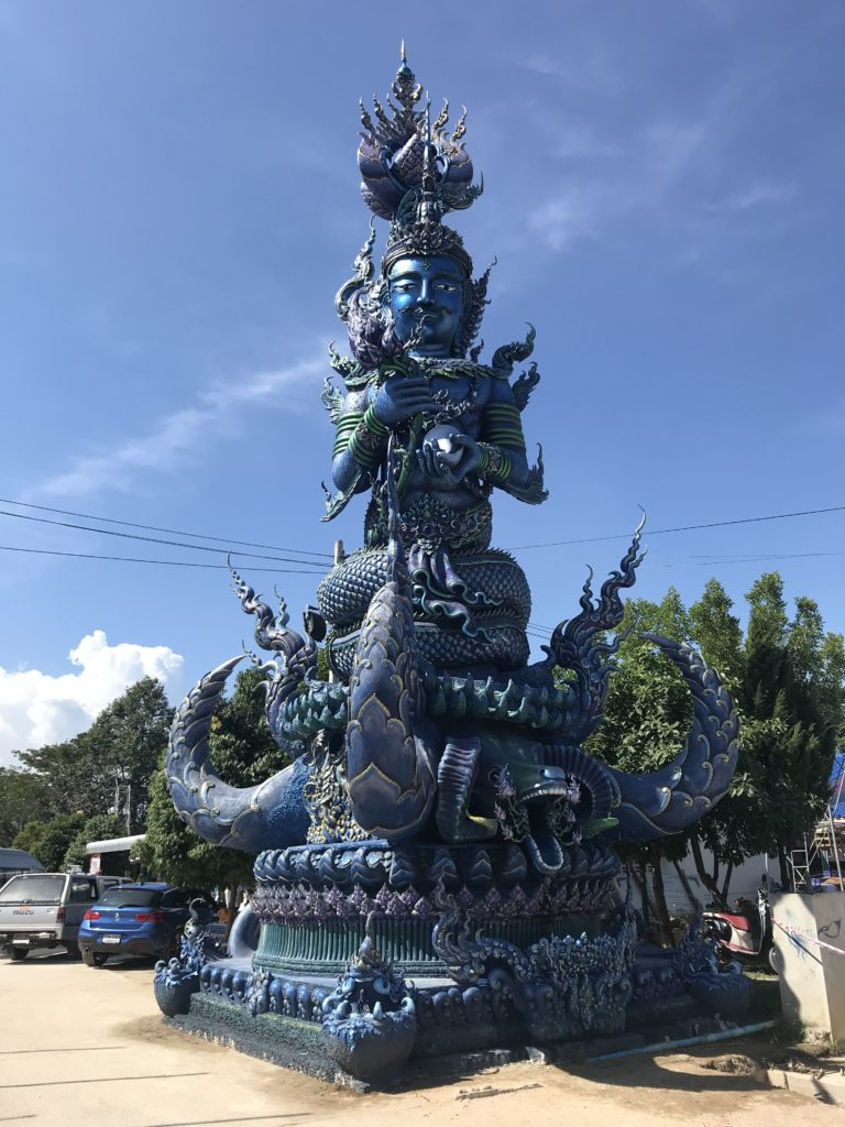 Statue at the entrance to the Blue Temple
