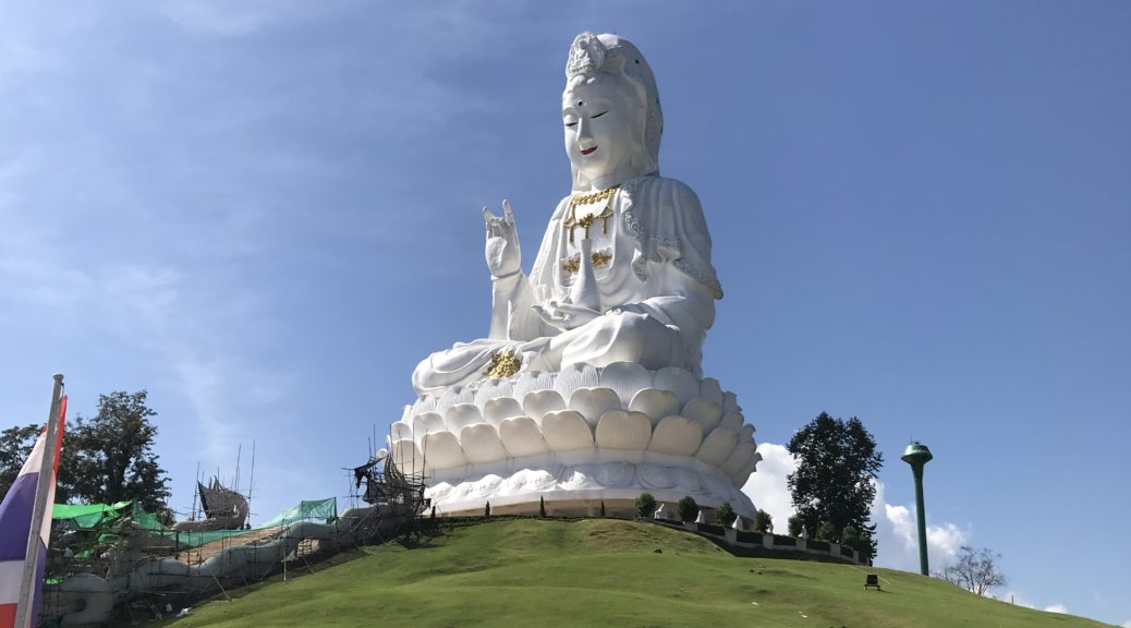 Giant Buddha statue at the 9 tier temple