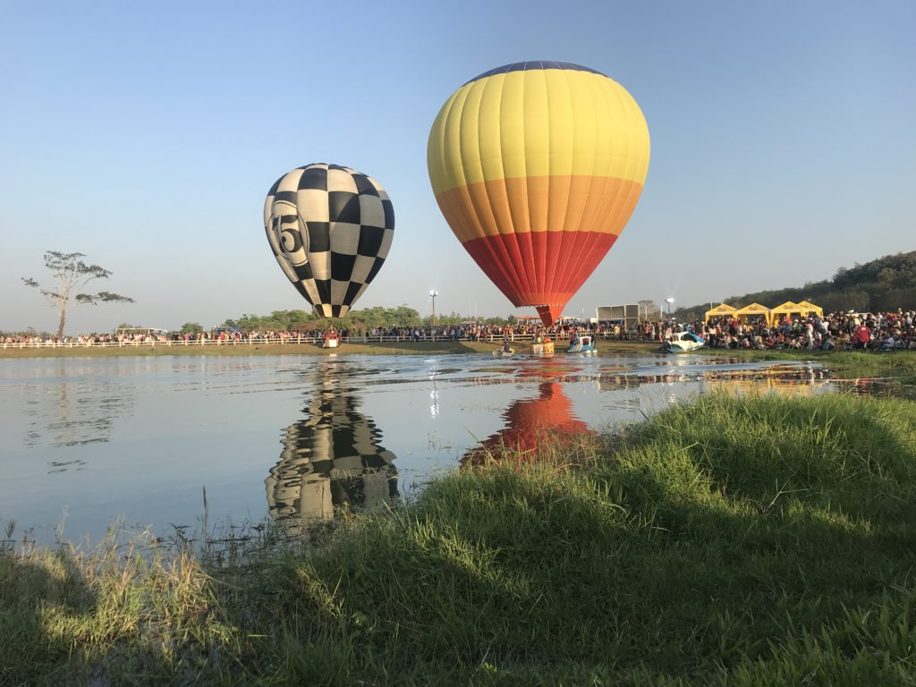 Hot air balloon landing in the lake
