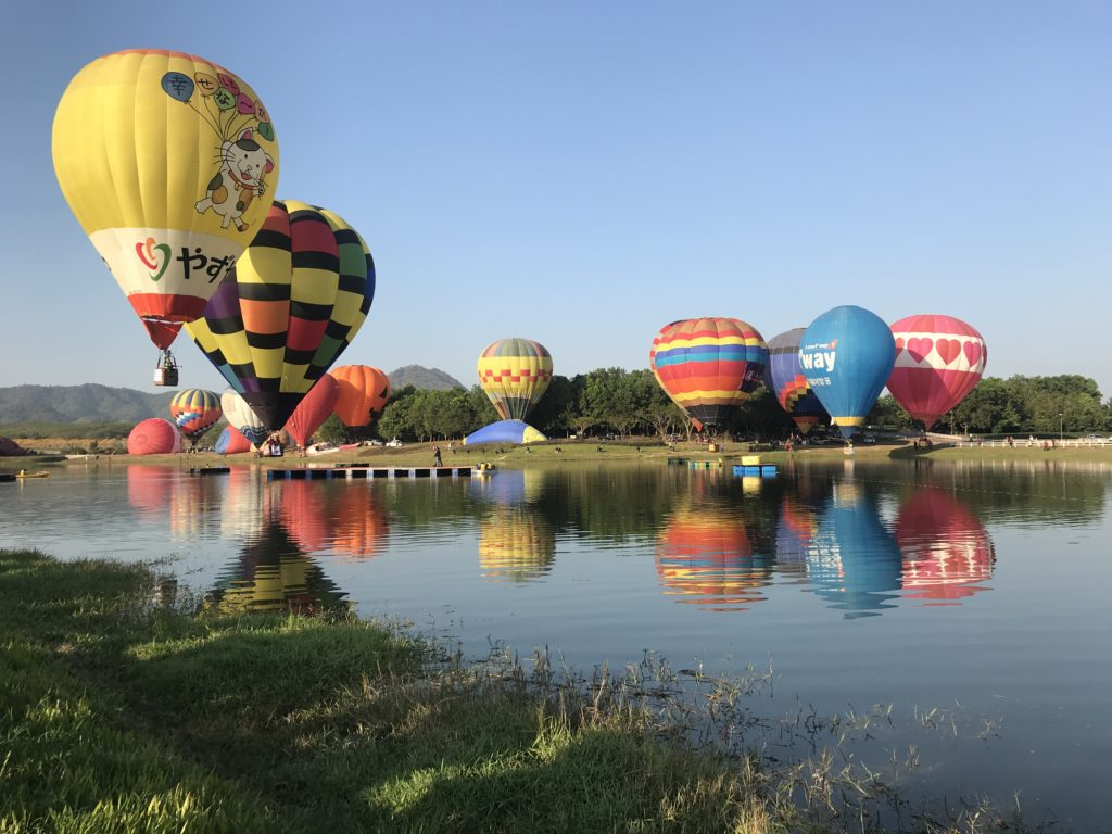Hot air Balloons over the lake at the Chiang Rai balloon festival