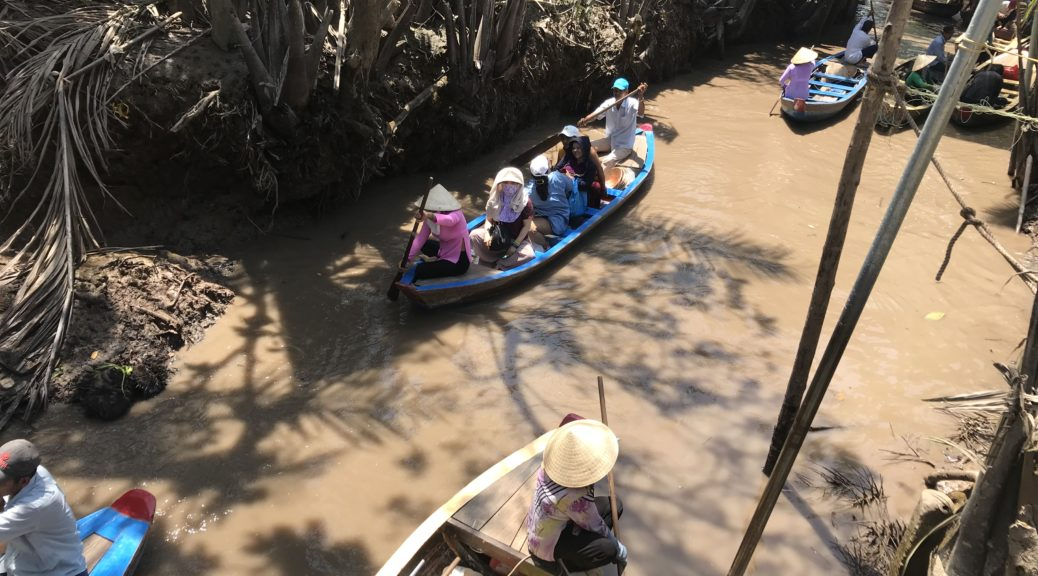 Row boat on Mekong river