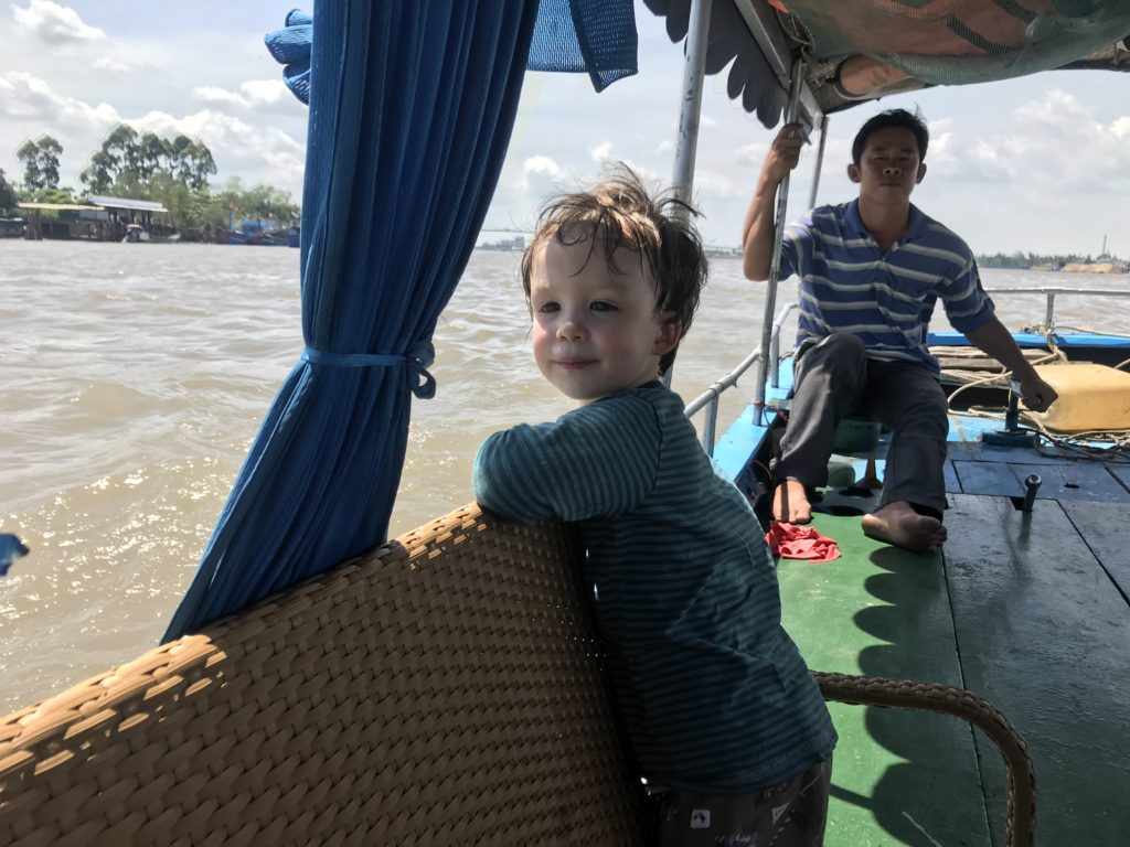 Image of a small boy looking over the edge of a boat